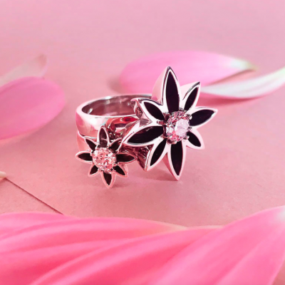 Two sizes of Flower cocktail diamond dress rings stacked together