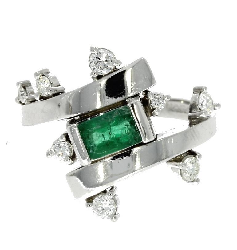 White gold, emerald & diamond wave-style set ring