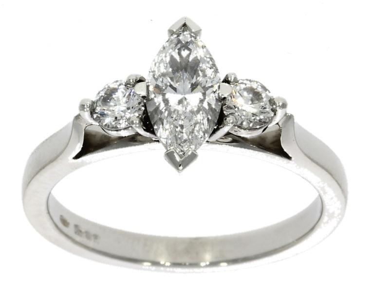Platinum, marquise cut central diamond ring