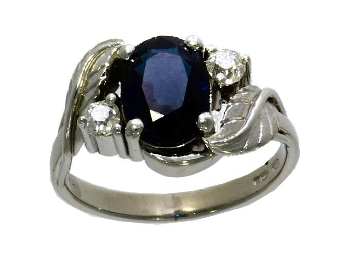 Platinum, sapphire & diamond three-stone ring