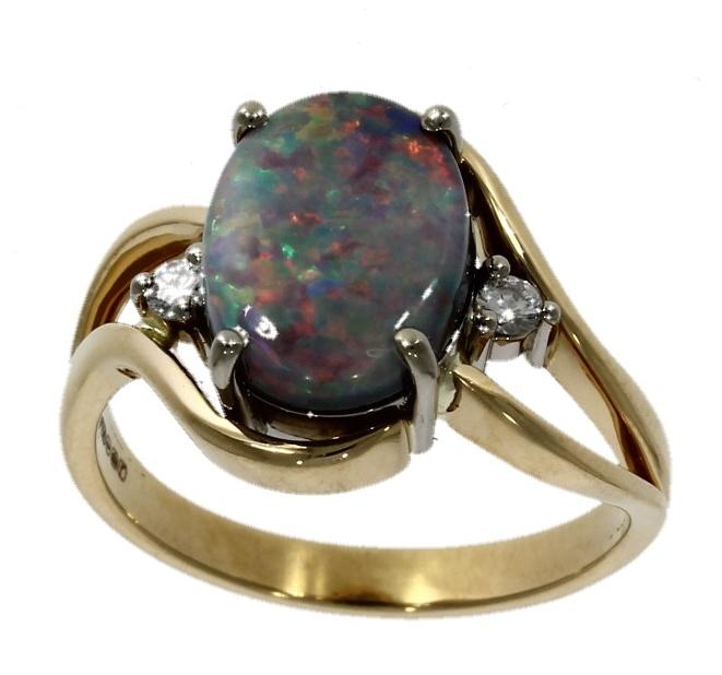 18ct yellow gold, black opal & diamond three stone ring
