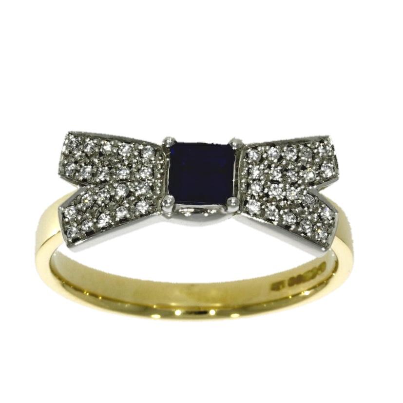 "Platinum, sapphire & diamond ""bow"" style ring"