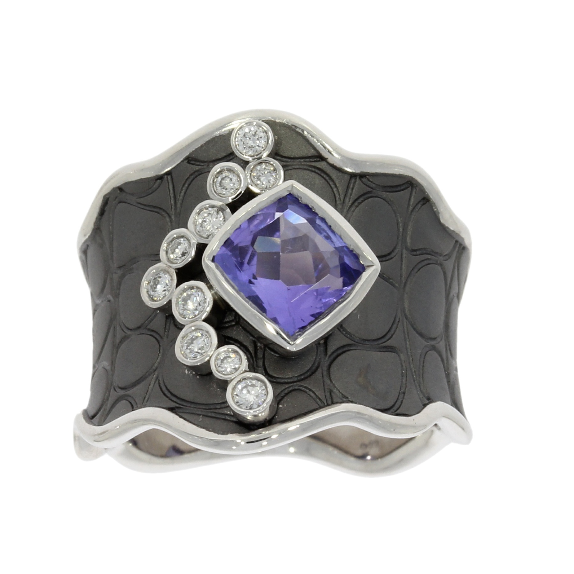 18ct white tanzanite and diamond dress ring with black rhodium.