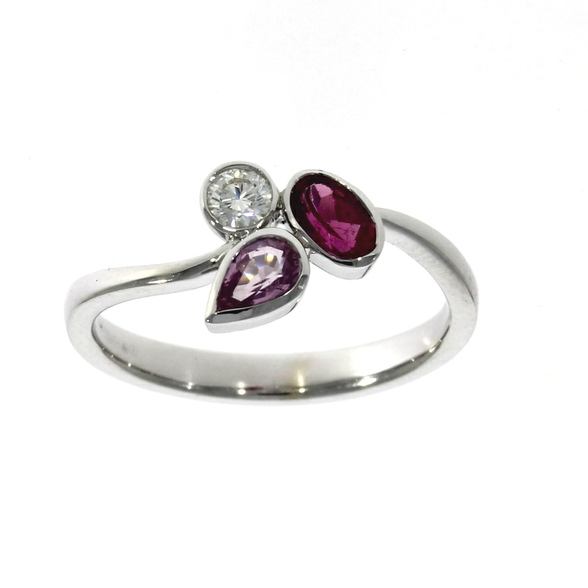 Platinum & 18ct white gold, pink sapphire, rubellite & diamond three stone ring