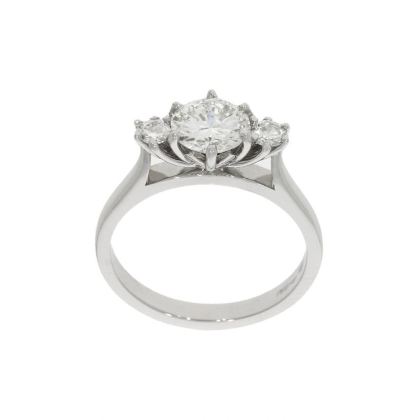 protea flower engagement ring design featuring a 3 diamond floral setting