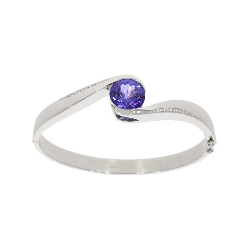 A bespoke platinum tanzanite and diamond hinged bangle