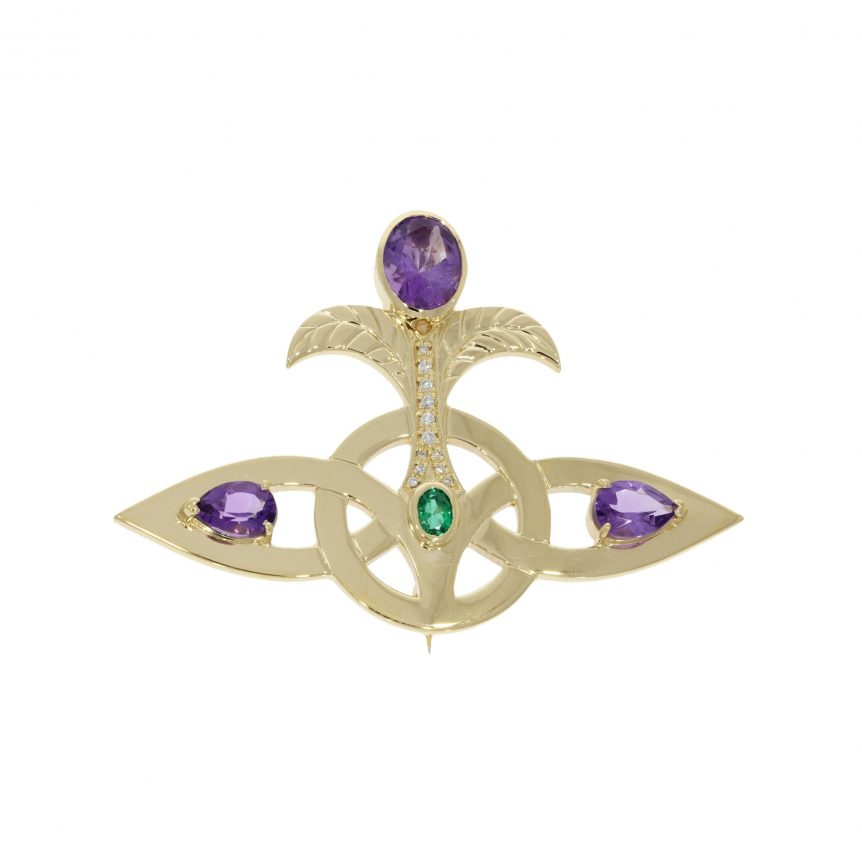 9ct yellow gold lovers knot brooch like vivienne westwood's logo with precious stones