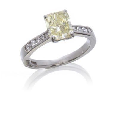 Platinum natural yellow diamond ring