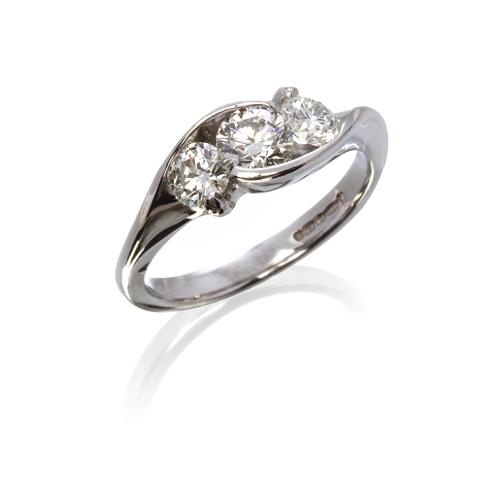 Diamond 3 stone crossover ring