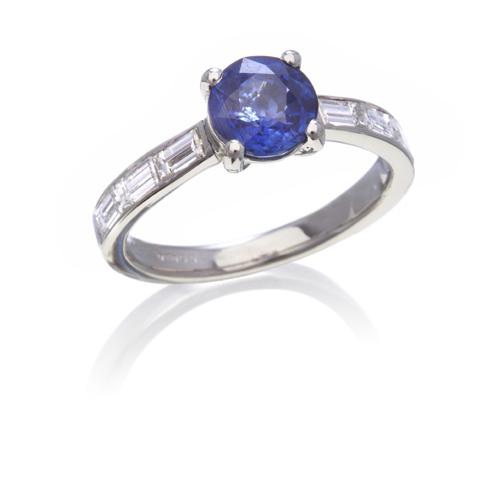 Platinum 7 stone sapphire and diamond ring