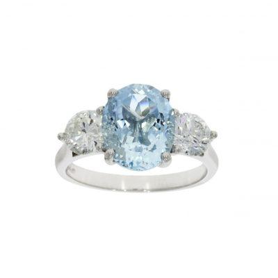 Three stone pastel blue aquamarine engagement ring