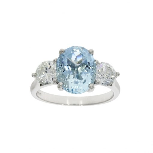 Three stone pastel blue aquamarine engagement ring