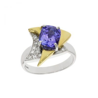 A mixed gold Star Trek badge inspired diamond and tanzanite abstract ring for the Trekkie