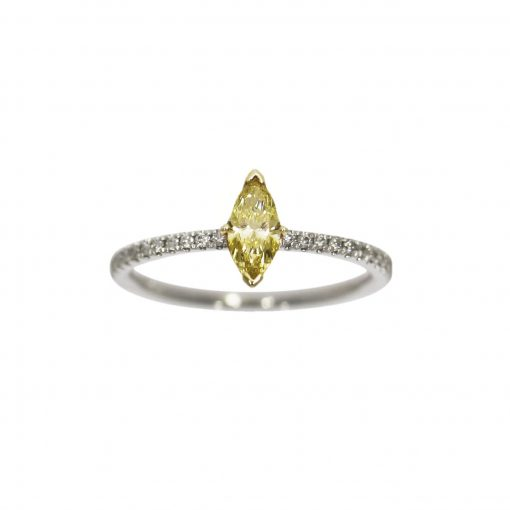 A marquise cut yellow diamond engagement ring with diamonds in the shoulders