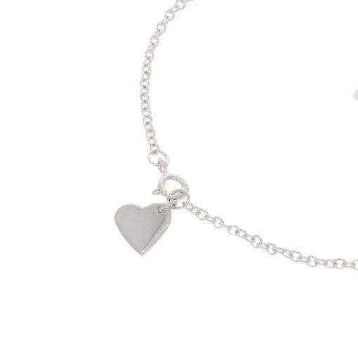 Close up on heart charm bracelet