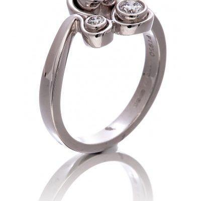 Diamond three stone swirl ring
