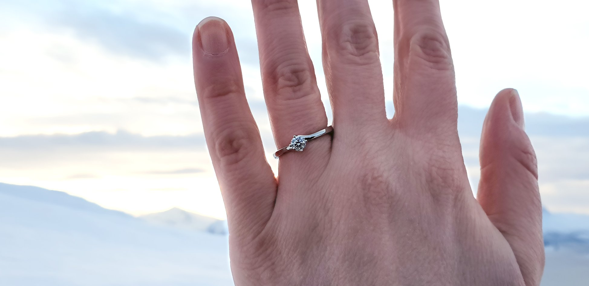 Romantic proposal and engagement ring in the snowy Norwegian mountains