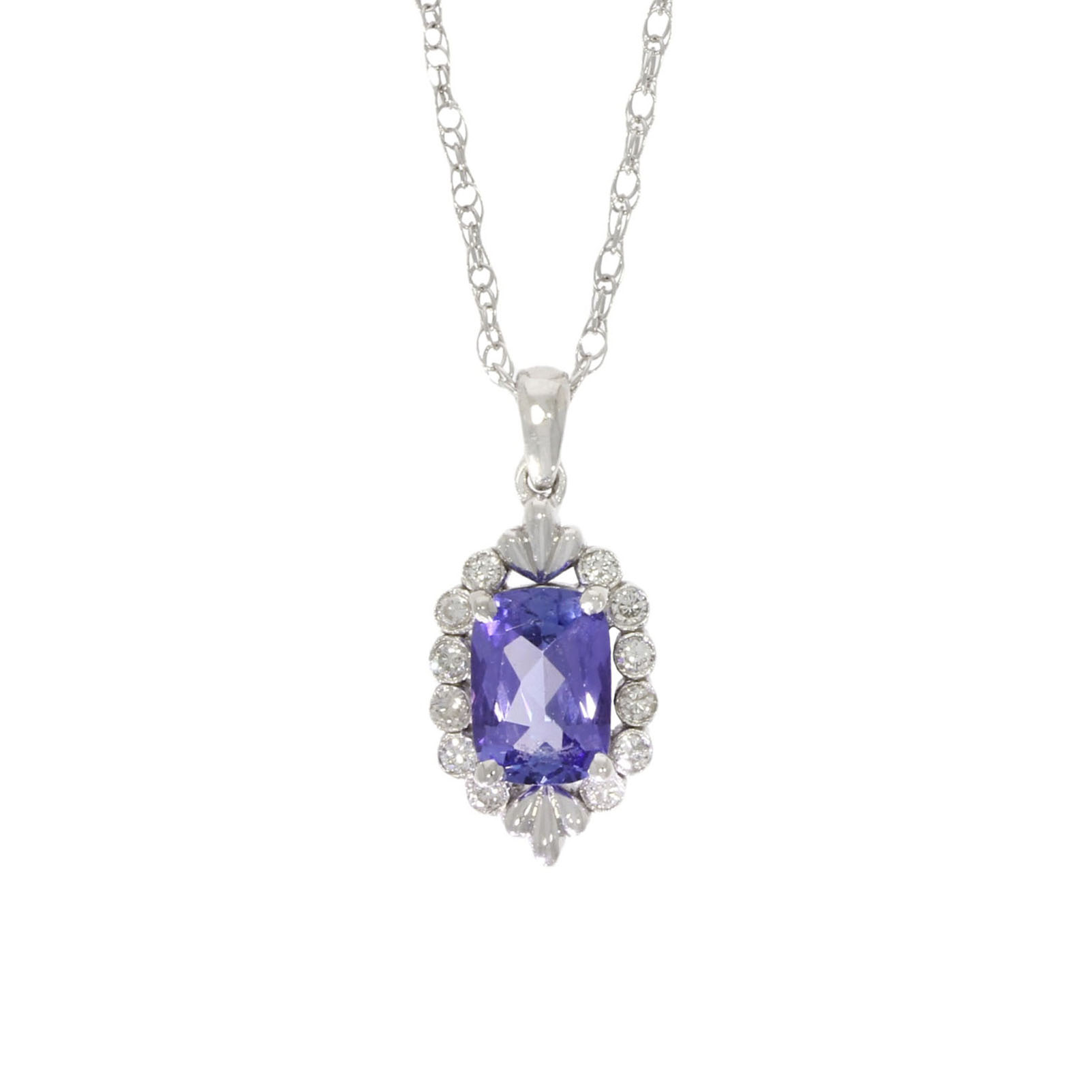 An tiny ornate diamond and tanzanite wylde couture jewellery piece
