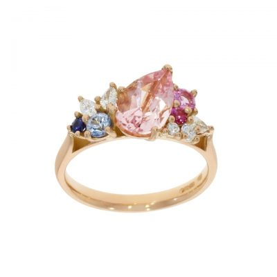 Multi coloured pink white and blue cluster asymmetric tilt engagement ring