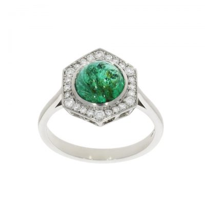 A cabochon cut emerald and diamond platinum cluster engagement ring