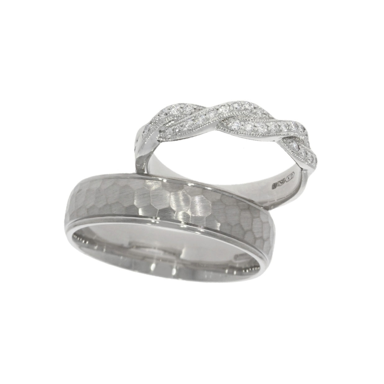 A bespoke wedding ring set in platinum and palladium each a different style