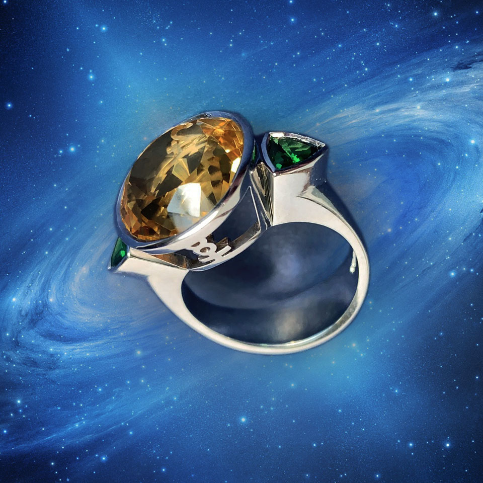 A galaxy ring made in the stars and personalised with glyphs