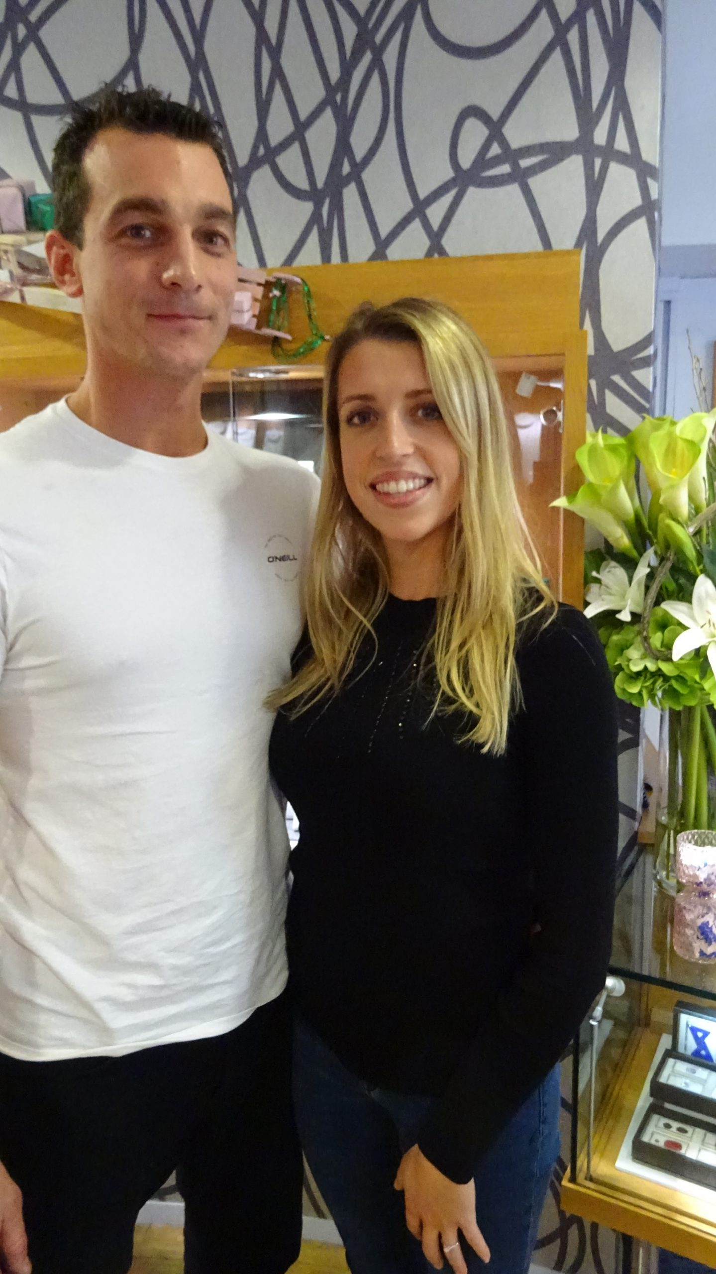engaged couple announcement happy customers seeing engagement ring first time