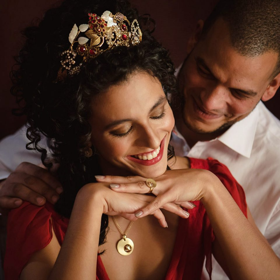 Yellow gold jewellery at a red colour schemed fire wedding photoshoot