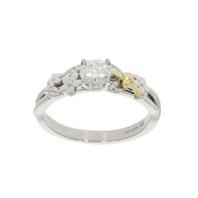 A bespoke Wylde Flower Diamond floral engagement ring with a yellow gold bee