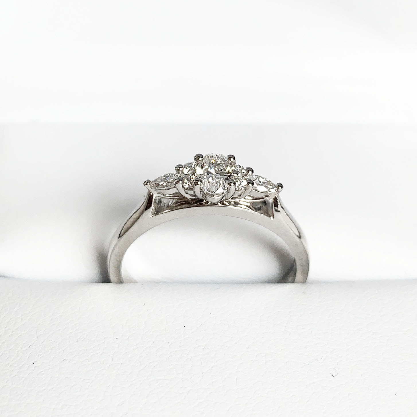 A three stone illusion engagement ring with different cut diamonds x7
