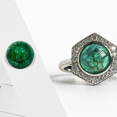 A contemporary emerald and diamond hexagonal ring