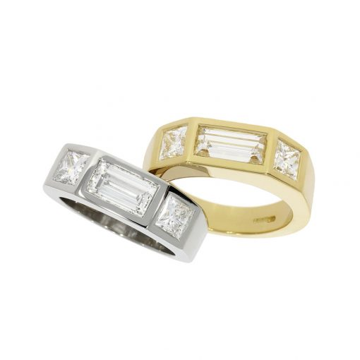 Two matching men's engagement wedding rings with subtle differences