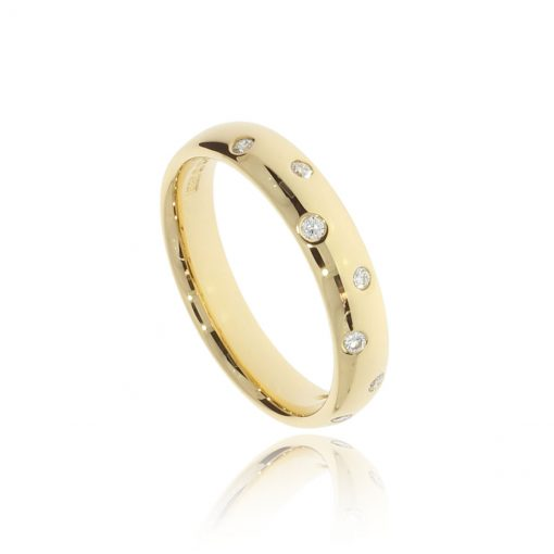 Random unique gold diamonds scattered unique unusual wedding band