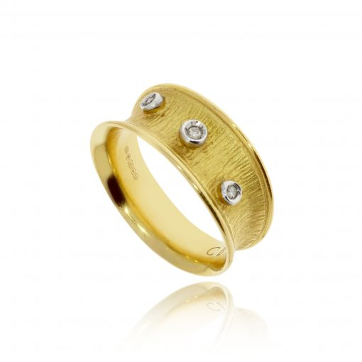 Solid yellow gold unusual and unique organic textured three diamond ring
