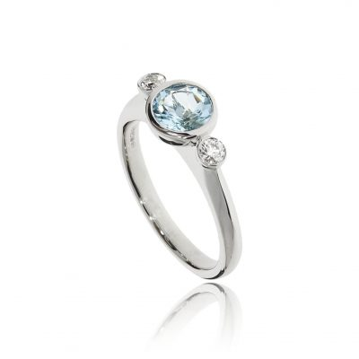 Coloured light pastel blue contemporary modern and classic engagement ring