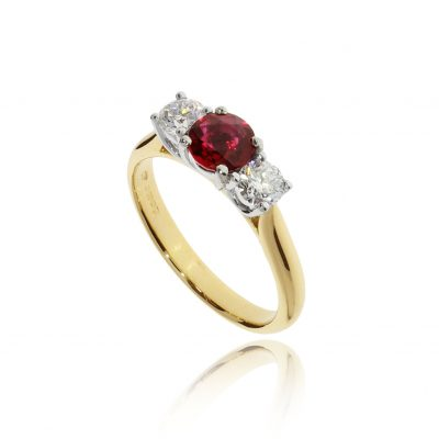 Classic romantic red ruby and diamond traditional engagement ring