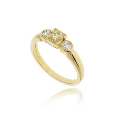 Yellow gold white and yellow diamond three stone engagement ring