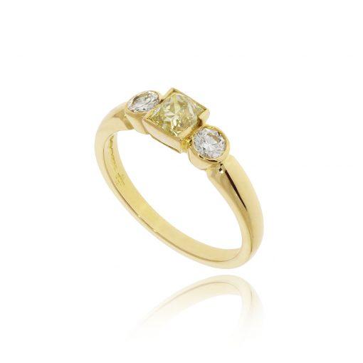 Yellow gold white and yellow diamond three stone engagement ring