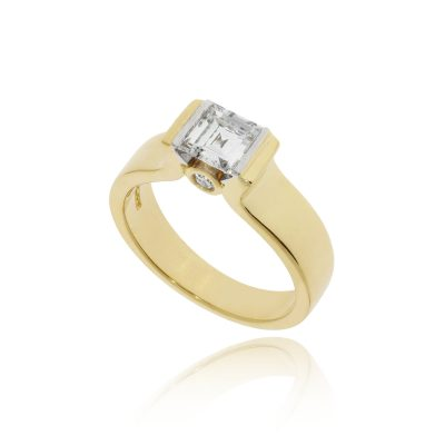 An unusual square yellow gold secret diamond detailed engagement ring